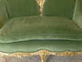 This Louis XV Style Velvet Loveseat with its elegant green velvet upholstery that sold for $210.